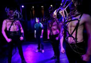 """Nathan Patrick Nelson, center, playing the role of Alan Strang in the Stage Left Theater production of """"Equus,"""" is flanked by """"horses,"""" played by Nick Bailye, far left, Craig Hudkins, second from left, and Scott Mackay, right."""