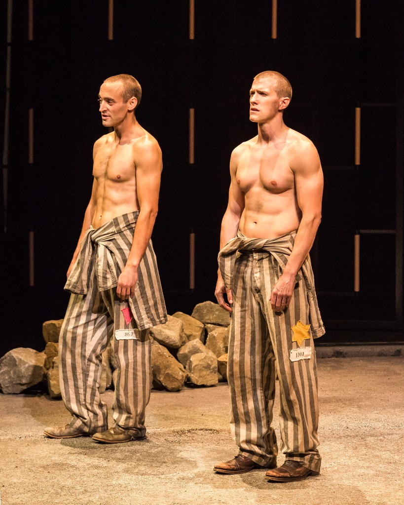 """L-R: Charlie Hofheimer and Patrick Heusinger in Martin Sherman's """"Bent,"""" directed by Moisés Kaufman, playing July 15 – August 23, 2015, at the Center Theatre Group/Mark Taper Forum. For tickets and information, please visit CenterTheatreGroup.org or call (213) 628-2772.   Contact:  CTG Media and Communications/ (213) 972-7376/CTGMedia@ctgla.org Photo by Craig Schwartz"""